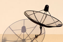 Home satellite dish and shadow Stock Photos