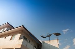 Home and satlelite on a roof with Blue sky. Home and receiver satlelite on a roof with Blue sky cloudy backgrounds Royalty Free Stock Images