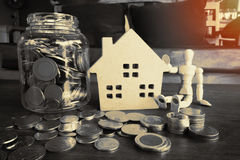 Home saving money for investing. Home concept ; money in the glass for housing loan and investment with filter effect retro vintage style stock images