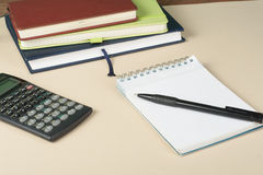 Home savings, budget concept. Chart, notepad, pen, calculator and coins on wooden office desk table. Royalty Free Stock Photos