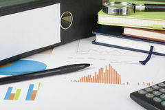 Home savings, budget concept. Chart, notepad, pen, calculator and coins on wooden office desk table. Stock Image