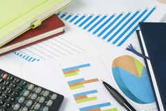 Home savings, budget concept. Chart, notepad, pen, calculator and coins on wooden office desk table. Stock Photo