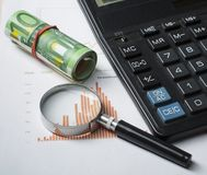 Home savings, budget concept. Chart. pen, calculator and coins on wooden office desk table. Home savings, budget concept. Chart, notepad, pen, calculator and Stock Photo