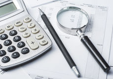 Home savings, budget concept. Chart. pen, calculator and coins on wooden office desk table Stock Images