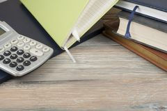 Home savings, budget concept. Notepad and calculator on wooden office table. royalty free stock image