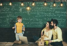Home schooling. Home schooling pupil at chalkboard. Home schooling education with parents. Family choose home schooling. Find a buddy to help you study stock photos