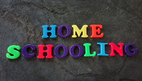 Home Schooling letters. Home Schooling spelled out in colorful play letters Stock Images