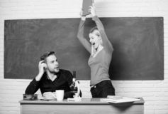 Home schooling. Modern school. Knowledge day. Back to school. Student life. Lesson and blackboard. Teachers day. Couple. Of men and women in classroom. funny royalty free stock image