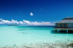 Home by the sea. Water Bungalow on an maldivian island in the indian ocean Royalty Free Stock Image