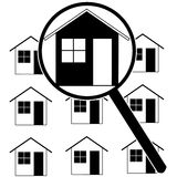 Home search. Icon set showing a magnifying glass identifying a home among rows of houses Stock Photos