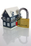 Home security. Small house with large padlock and chain on white background royalty free stock images