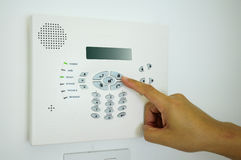 Home security alarm. Settiing a home security system for protection Royalty Free Stock Photography