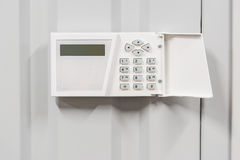 Home security alarm on white wall Stock Image
