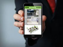 Home security businessman smartphone. New technologies concept: businessman hand holding a 3d generated touch phone with security cam on the screen. Screen Stock Photography