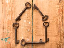 Home security concept. House composed of keys royalty free stock image