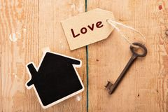 Home security concept. Little house and old key stock images