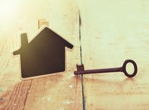Home security concept. Little house and old key stock photo