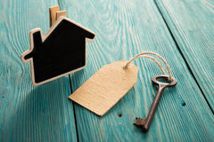 Home security concept. Little house and old key Stock Photography