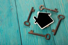 Home security concept. Little house and old keys stock photography