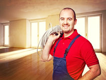 Home service. Craftman and house indoor background Royalty Free Stock Photos