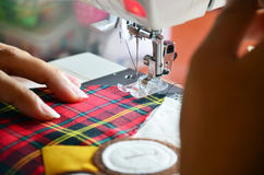 Home Sewing Machine. This picture is sewing a doll owl at my home. Home sewing machines are designed for one person to sew individual items while using a single royalty free stock photo