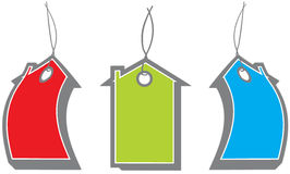 Home Shapes Sale Tags. Vector red green blue house price labels Stock Photography