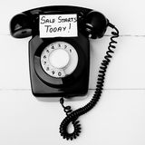 Home shopping sales concept. Retro black telephone with sales message, great old fashioned home shopping concept Royalty Free Stock Image