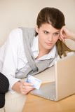 Home shopping - woman with credit card and laptop Stock Image