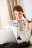 Home shopping - woman with credit card and laptop Royalty Free Stock Images