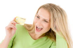 Home shopping - young woman holding credit card Stock Photos