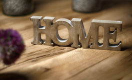 Home sign balanced on wooden table normal- rest and relaxation Stock Image