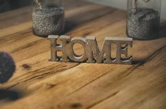 Home sign balanced on wooden table- rest and relaxation Royalty Free Stock Photos