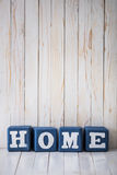 HOME sign made of wooden blocks on wooden background Stock Image