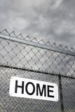 Home sign on metal fence. Royalty Free Stock Photos