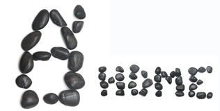 Home sign shape out of black stones Stock Images