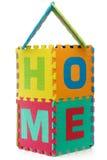HOME - sinal com letras do enigma do alfabeto no branco Fotografia de Stock Royalty Free
