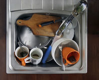 Home sink. Full of dirty dishes Stock Photo