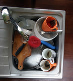 Home sink. Full of dirty dishes Royalty Free Stock Photography