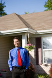 Home: Smiling Real Estate Agent. Extensive series of a Caucasian Real Estate Agent and African-American Couple in front of a home stock photos