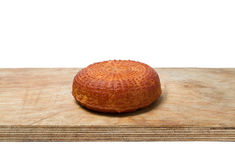 Home smoked rustic cheese isolated on a white background Stock Photography