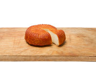 Home smoked rustic cheese isolated on a white background Stock Photo