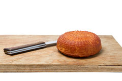 Home smoked rustic cheese isolated on a white background Royalty Free Stock Photos
