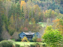 Home in the Smokies. This is a photo taken from the car window. I managed to capture this pretty house in the woods among the fall colors Stock Photos