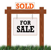 Home Sold Sign. Wooden Real Estate For Sale Sign with a Sold sign attached Stock Images