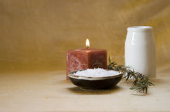 Home spa. Items for pampering yourself: candle, sea salt, rosemary, oil Royalty Free Stock Image