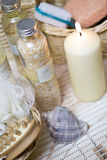Home spa. A composition of spa items. The arrangements includes a cadle, sea-shell, bottles, scrub and brush Stock Photography