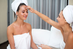 Home spa beauty pure clean skin care women applying facial homemade mask Royalty Free Stock Photos