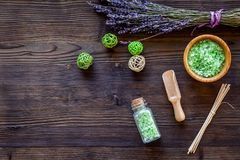 Home spa with lavender herbs cosmetic salt for bath on wooden desk background top view mock-up Royalty Free Stock Image