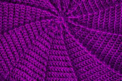 Home spiral double crochet in circle cap background. Spiral knitting of violet wool by handmade crocheting around beret royalty free stock photography