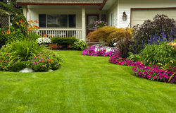 Home Spring Summer Manicured Garden. A finely manicured yard show its summer/spring colors Royalty Free Stock Photos
